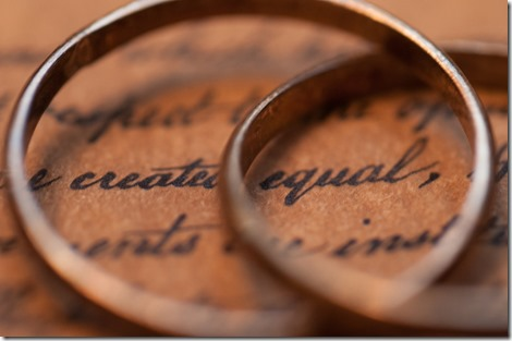 "wedding rings over words ""created equal"""