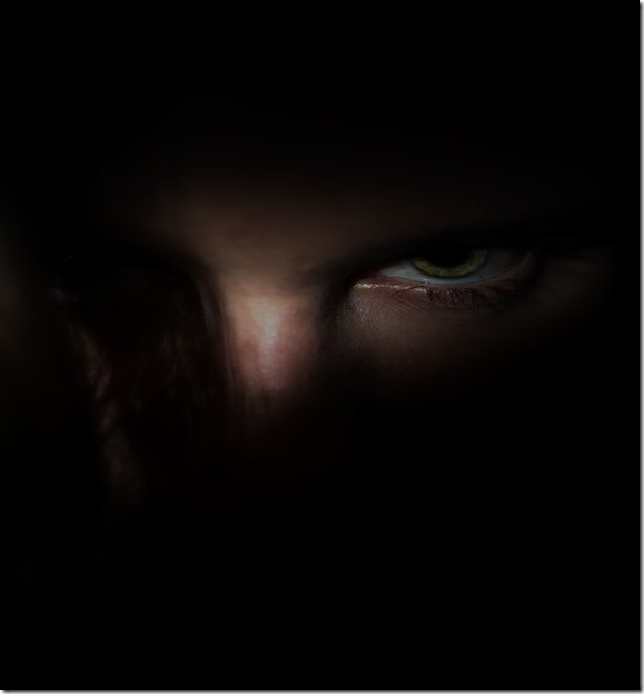 man's face looking sinister and evil